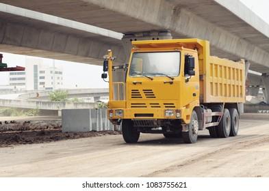 yellow drump truck