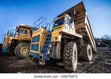 Yellow dump trucks ready to work
