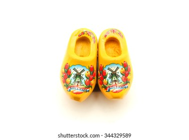 Yellow Dutch clog with Holland isolated on white