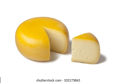 Yellow Dutch Gouda cheese with a piece on white background