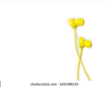 Yellow earbuds isolated on white background