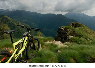 yellow electric bicycle, e-bike, ebike, mtb, valley, mountains, forest, summer, sport, adventure, freedom, alps, peak of Mount Legnone, Como Lake, Lombardy, Italy