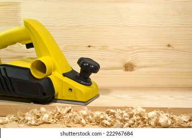 yellow electric plane on a board of wood