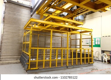 Yellow Elevator in loading bay to load heavy machine inside building or exhibition center which good for Car, installation material, Construction things and Big Size Booth kiosh