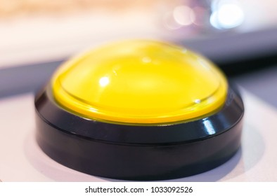 Yellow emergency stop and start vintage button