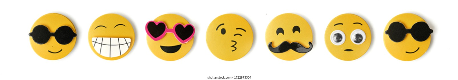 Yellow emoticons expressing emotions on a white background