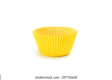 Yellow empty cupcake cases isolated on white