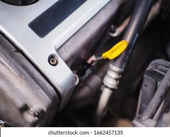 Yellow engine oil level gauge