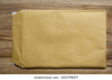 yellow envelope on a wooden table