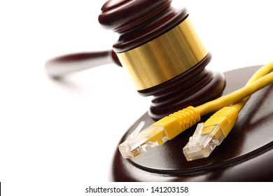 Yellow ethernet cable and wooden gavel