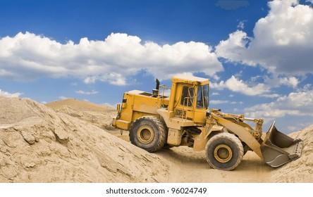 yellow excavator in quarry