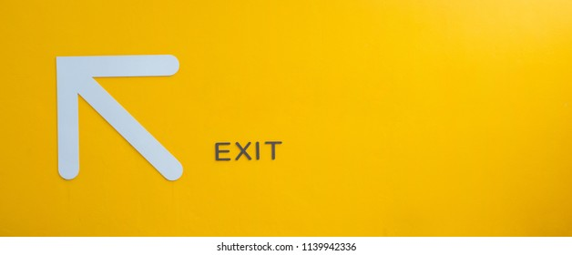 Yellow exit sign, empty space