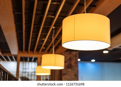 The yellow fabric lampshades ceiling. colorful, decorative, electrical, furniture, illumination, lamp, lampshade, style, textile, abstract background, hanging lamp, interior design.