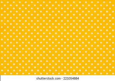 Yellow fabric with white polka dots