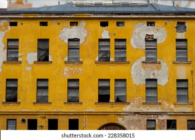 A yellow facade of an  old decaying building