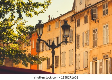 Yellow facades of traditional old houses in Aix-en-Provence