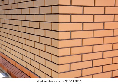 Yellow Facing Brick Wall with a smooth surface in the corner