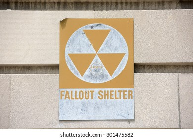 yellow fallout shelter sign on a building