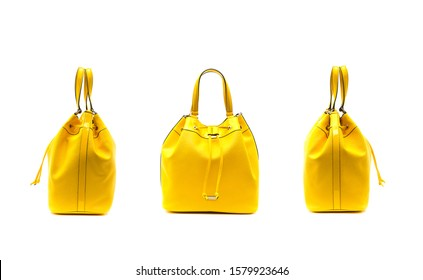 Yellow female handbag isolated on white background. Female handbag in row. Yellow female handbags. Yellow handbag