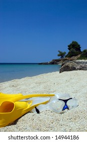 Yellow Fin and Dive mask on the beach