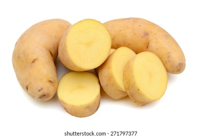 yellow fingerling potatoes on white background