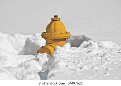 Yellow Fire Hydrant buried in snow in Manassas, Virginia