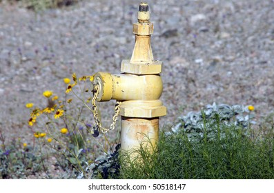 Yellow Fire Hydrant in the desert.
