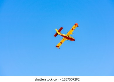yellow fire-fighting plane is going to throwing water on fire at marseille airport.