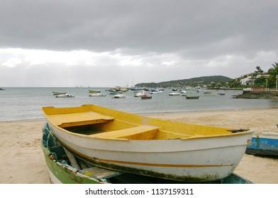 yellow fishman boat on the beach in the Buzios, Brazil
