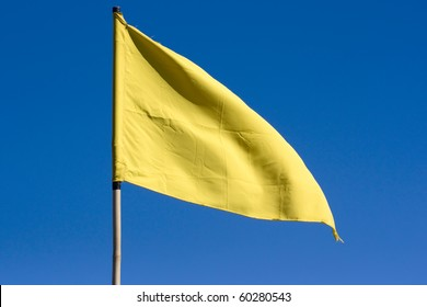 Yellow flag with blue sky