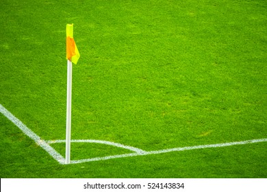 Yellow flag in corner of football playground, lazy wind blowing.