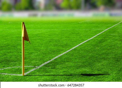 Yellow flag in corner of football playground, blurred concept