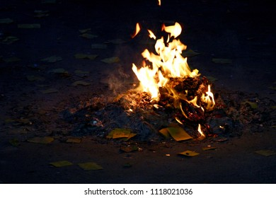 The yellow flame at night. The religious ceremony of burning paper money of the traditional Taiwanese Taoism religion.