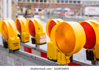 Yellow flashing light standing at road construction site. Road works concept.
