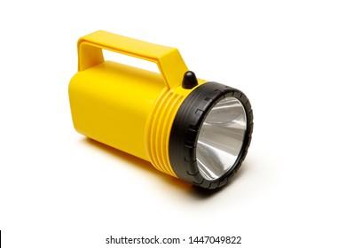 Yellow flashlight isolated on the white background