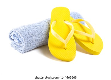 yellow flip flop shoes and towel isolated on white background