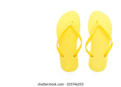 Yellow flip flops isolated on white background