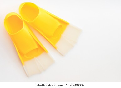 Yellow flippers on a gray background. Illuminating Yellow flippers  for swimming. Copy space.