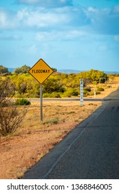 Yellow Flood way street sign in Australian Outback