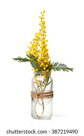 yellow flowers in glass jar