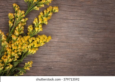 yellow flowers on wooden background. Flowers on vintage wood background. selective focus.