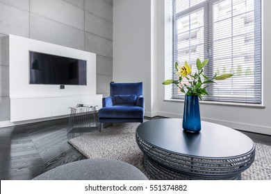 Yellow flowers in vase on decorative coffee table