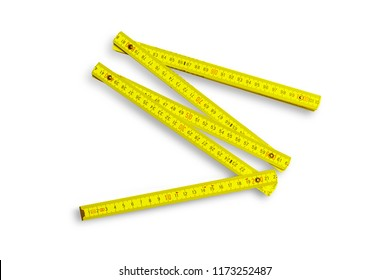 Yellow folding rule measuring tool isolated on white background
