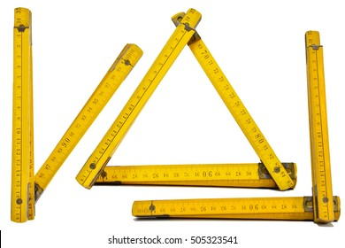 yellow folding ruler with white background,v,l,triangle