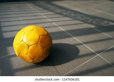Yellow football at home yard
