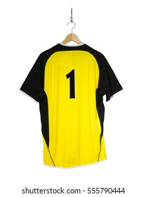 Yellow Football shirt number one hanging on hook and isolated on white background