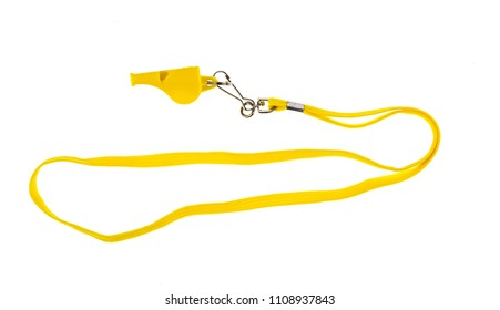 yellow football whistle on white isolated background