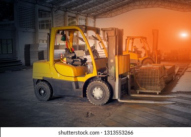Yellow forklift in the factory building.