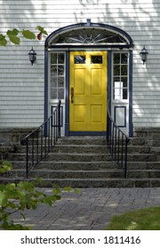 Yellow Front Door On An Old North American Traditional House