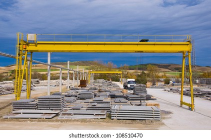 Yellow gantry crane with construction elements